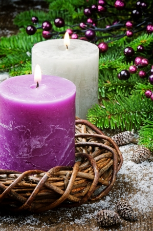 christmas tree purple: Burning candles on festive Christmas background with ornaments