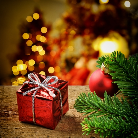 Christmas present on festive lighted background Imagens