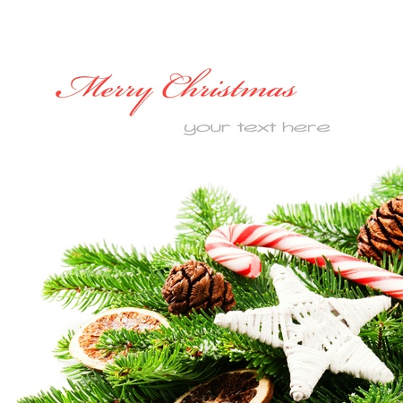 Border with Christmas tree branches and vintage decorations isolated over white photo