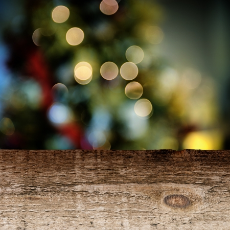 wooden insert: Old wooden table with colorful festive background