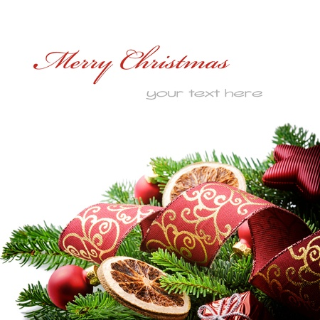 Border with Christmas tree branches and festive decorations isolated over white