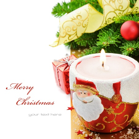 Red Christmas candle on festive background isolated over white photo