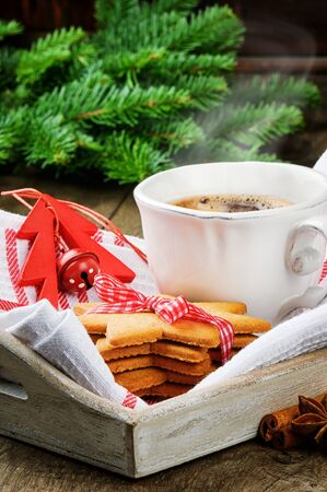 Christmas coffee and gingerbread cookies in festive setting photo