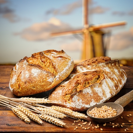 homemade bread: Freshly baked traditional bread on wooden table