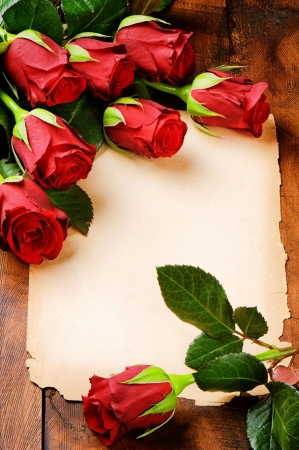 Romantic frame with red roses and vintage paper Stock Photo