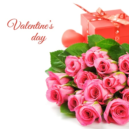 Bouquet of pink roses with Valentine's present isolated over white photo