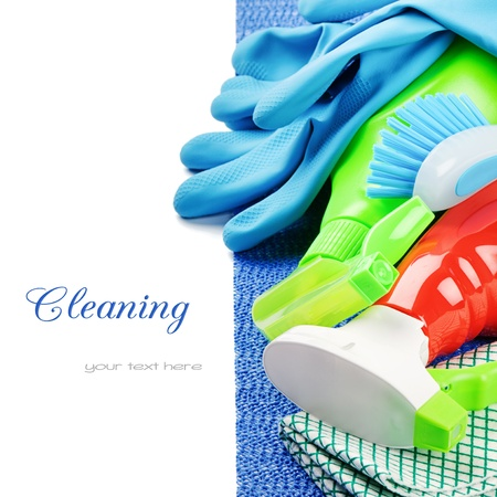 Domestic cleaning: Colorful cleaning products isolated over white Stock Photo