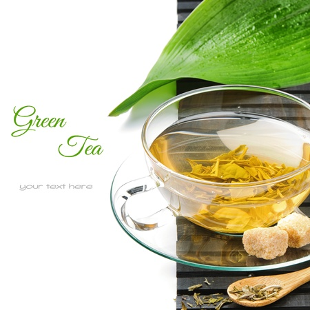 Cup of hot green tea isolated over white photo