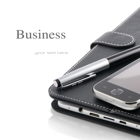 Business concept. Mobile phone, tablet pc and pen isolated over white photo