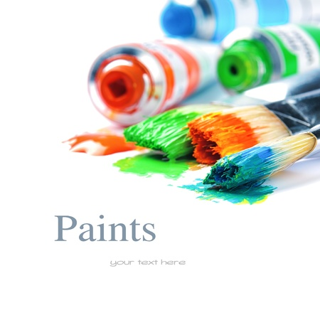 art work: Colorful paints and artist brushes isolated over white Stock Photo