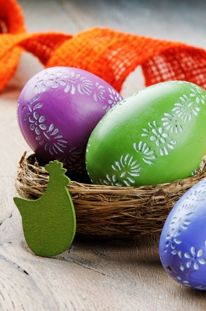 Colorful Easter eggs on wooden table photo