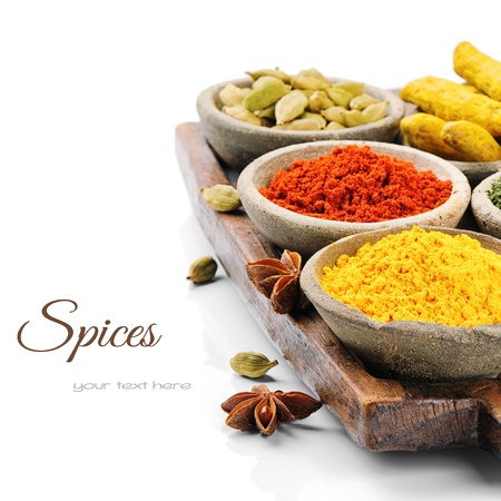 indian spice: Colorful mix of spices isolated over white