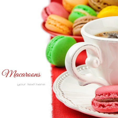 Colorful macaroons and coffee isolated over white photo