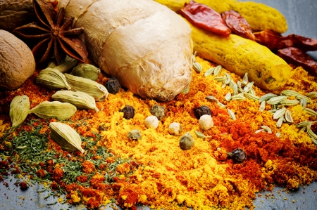 Colorful mix of different spices on stone background photo