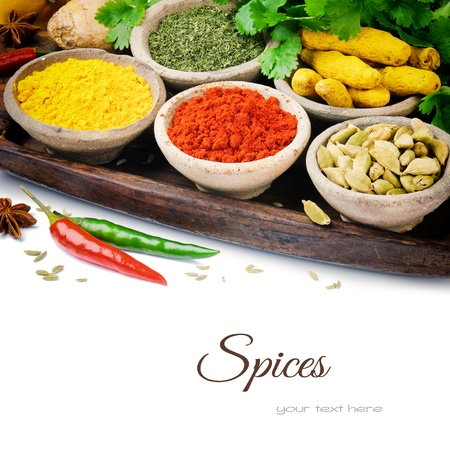 indian cooking: Colorful mix of spices isolated over white