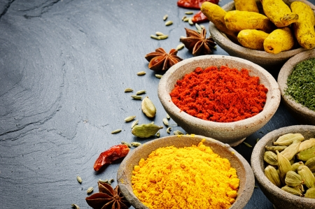 asian indian: Colorful mix of spices on stone background Stock Photo