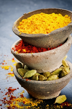 Stack of colorful mix of spices on stone background photo