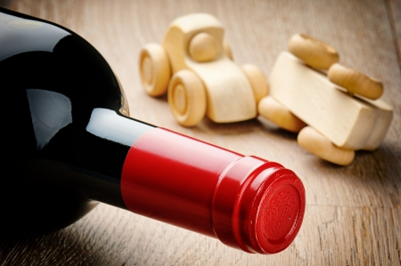 wine road: Anti-drink driving concept with bottle of wine Stock Photo