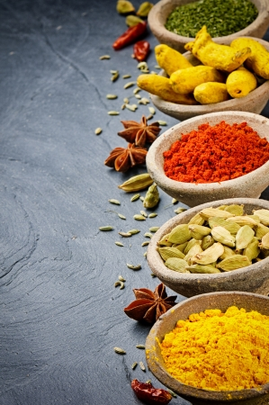 aroma bowl: Colorful mix of spices in old bowls on stone background Stock Photo