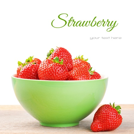 Fresh strawberry in a bowl isolated over white Stock Photo - 19007546