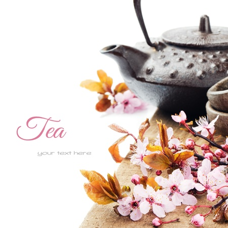Asian tea pot with cherry blossom isolated over white photo