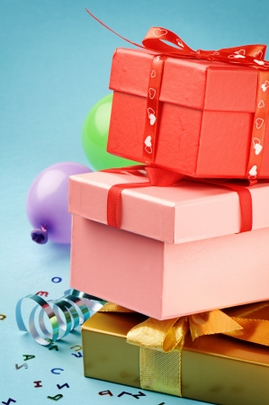 Stack of colorful gift boxes on blue background photo