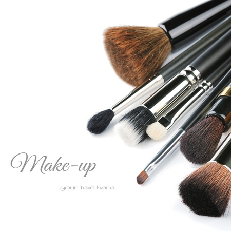cosmetics collection: Various makeup brushes isolated over white