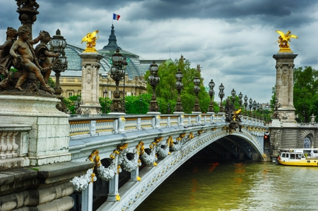 Beautiful bridge of Alexandre III in Paris at cloudy day photo