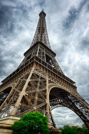 Eiffel Tower in Paris at cloudy summer day photo