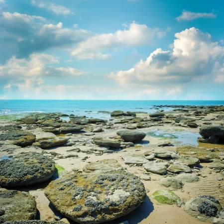 Rocky coast of northern France at summer day photo