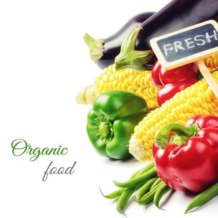 Fresh organic vegetables isolated over white photo