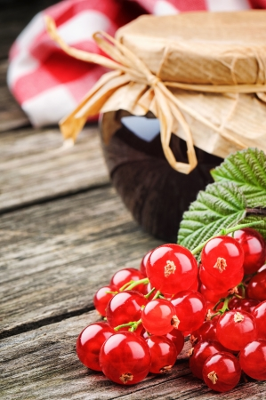 Redcurrant jam and fresh berries on wooden table Stock Photo - 20370026