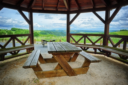 bower: Wooden picnic place with green valley background