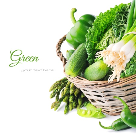 Fresh green vegetables in wicker basket photo