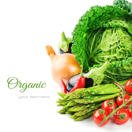 Fresh organic vegetables isolated over white photo