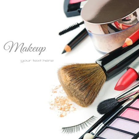 makeup a brush: Colorful makeup products isolated over white