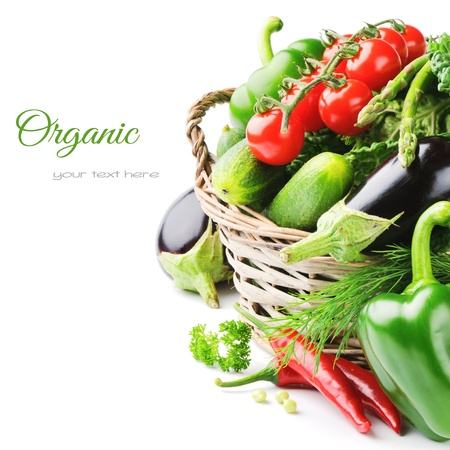 organic background: Fresh organic vegetables in wicker basket Stock Photo