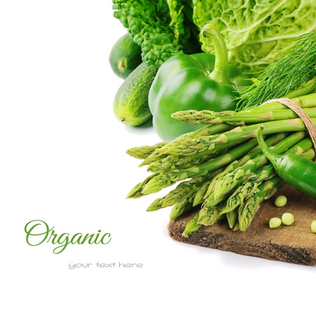 Fresh green vegetables on wooden cutting board photo