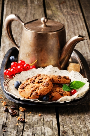 Chocolate chip cookies and coffee in vintage setting photo