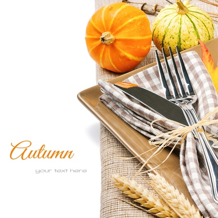 Autumn table setting with pumpkins isolated over white photo