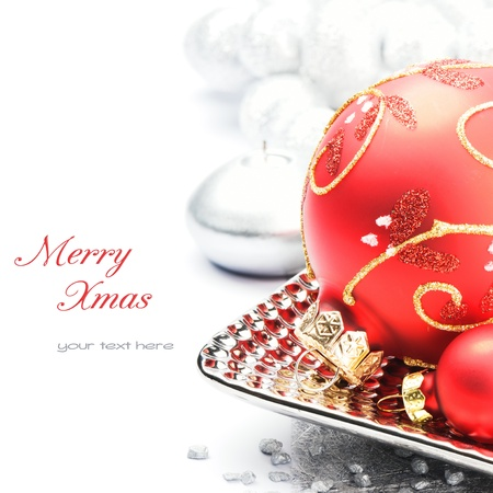 Red Christmas ball on festive background photo