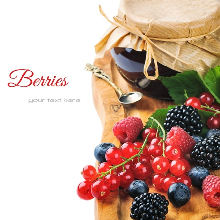 marmalade: Freshly made jam and organic berries isolated over white