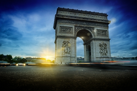Arc de Triomphe at night. Beautiful sunset over Place de lEtoile, Paris photo