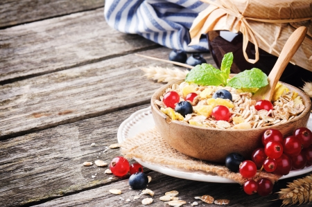 Bowl with cereals and fresh berries on wooden table Stock Photo - 22705981