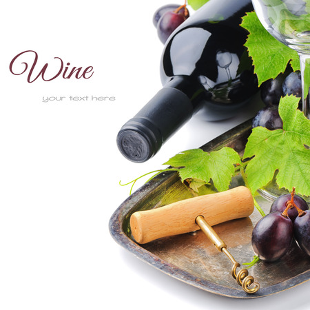 Bottle of red wine and and corkscrew on silver tray photo