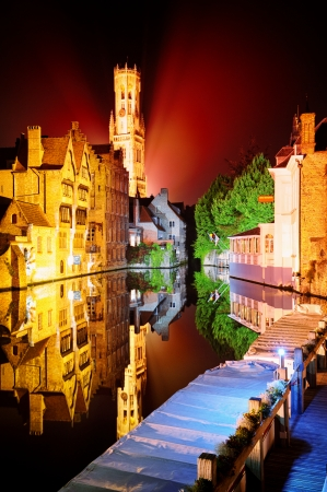 Night view of Bruges with Belfry tower in the background photo