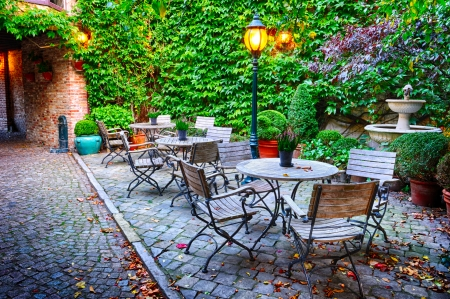 the place is outdoor: Cosy cafe terrace in Bruges, Belgium