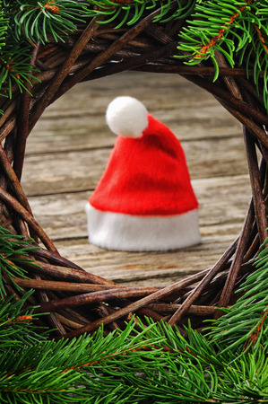 Santa hat in festive Christmas setting photo