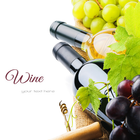 Bottles of red and white wine with fresh grape isolated over white Stock Photo