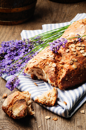 Rustic setting  with fresh traditional bread photo